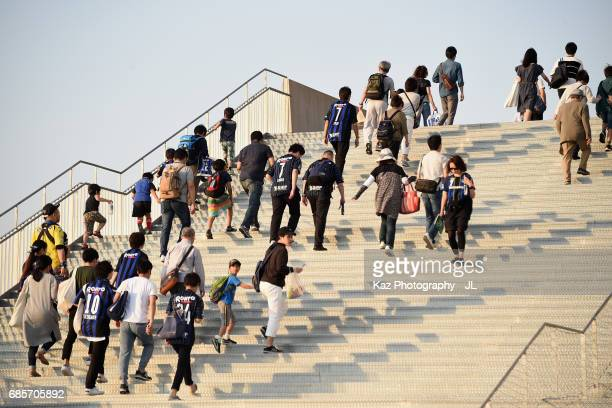 Fans make their way to the stadium prior to the JLeague J1 match between Gamba Osaka and Sagan Tosu at Suita City Football Stadium on May 20 2017 in...