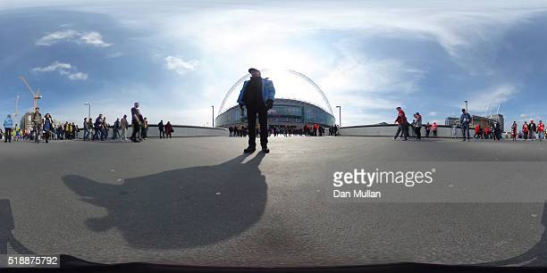 Fans make their way to the stadium prior to the Johnstone's Paint Trophy Final between Oxford United and Barnsley at Wembley Stadium on April 3 2016...