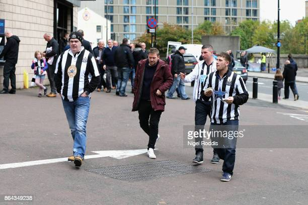Fans make their way to the stadium prior to the Premier League match between Manchester City and Burnley at Etihad Stadium on October 21 2017 in...