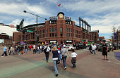 Fans make their way toward the stadium as the Colorado Rockies host the Arizona Diamondbacks during Opening Day at Coors Field on April 1 2011 in...