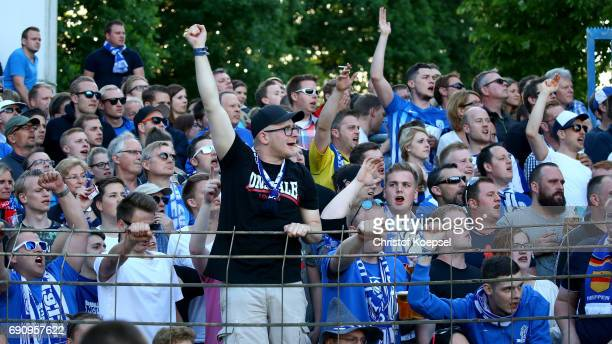 Fans me00 celebrate during the Relegation Regionalliga Play Off second leg match at Hensch Arena on May 31 2017 in Meppen Germany