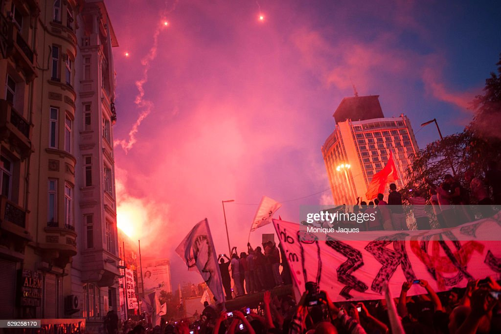 Fans merge in Taksim square lighting flares and fireworks Hundreds of thousands of football fans from the three major Istanbul teams march on...
