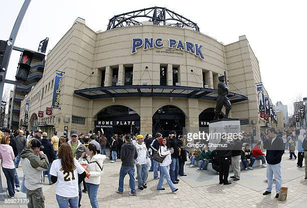 Fans mill around outside the ballpark on opening day for the Pittsburgh Pirates prior to playing the Houston Astros at PNC Park April 13 2009 in...