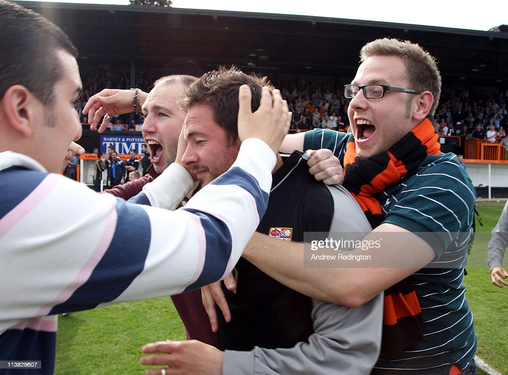 Fans mob Barnet manager, Giuliano Grazioli, after their victory ensures their league survival in the npower League Two match between Barnet and Port Vale at Underhill Stadium on May 7, 2011 in Barnet, England.