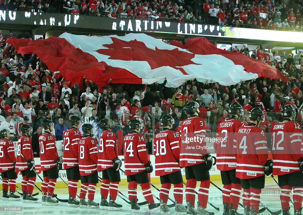 Fans move a large Canadian flag during the singing of the national anthems prior to a game of Team Canada against Team USA during the 2009 IIHF World...