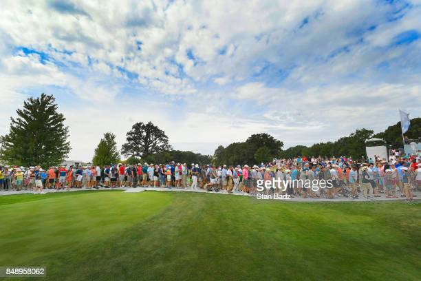 Fans move along the first hole during the final round of the BMW Championship at Conway Farms Golf Club on September 17 2017 in Lake Forest Illinois