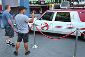 Fans observing the 'Ghostbusters' Cadillac Fleetwood Station Wagon at AMC Universal City Walk on July 14 2016 in Universal City California