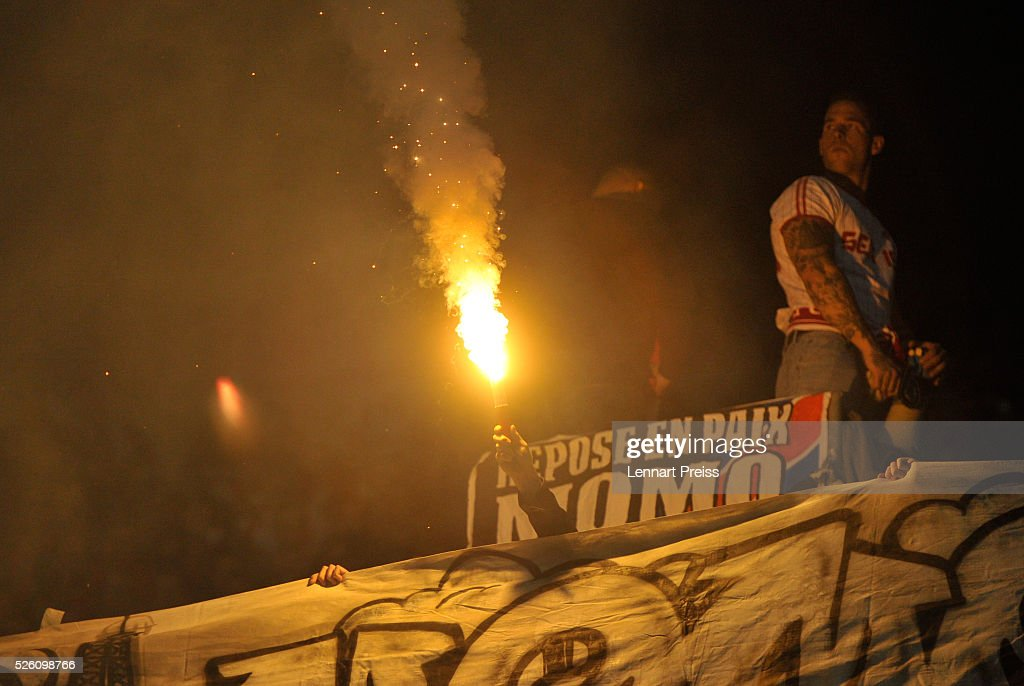 Fans of 1. FC Koeln burn a flare during the Bundesliga match between FC Augsburg and 1. FC Koeln at WWK Arena on April 29, 2016 in Augsburg, Germany.