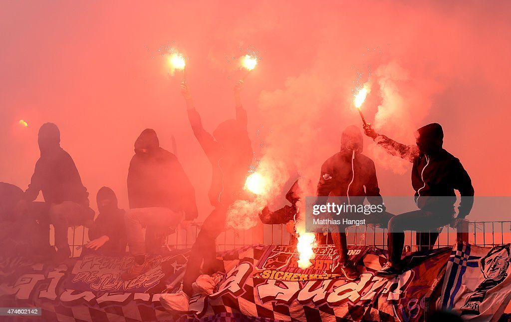 Fans of 1860 Muenchen light fireworks during the Second Bundesliga match between Karlsruher SC and 1860 Muenchen the at Wildpark Stadium on May 24, 2015 in Karlsruhe, Germany.