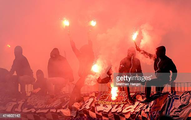 Fans of 1860 Muenchen light fireworks during the Second Bundesliga match between Karlsruher SC and 1860 Muenchen the at Wildpark Stadium on May 24...