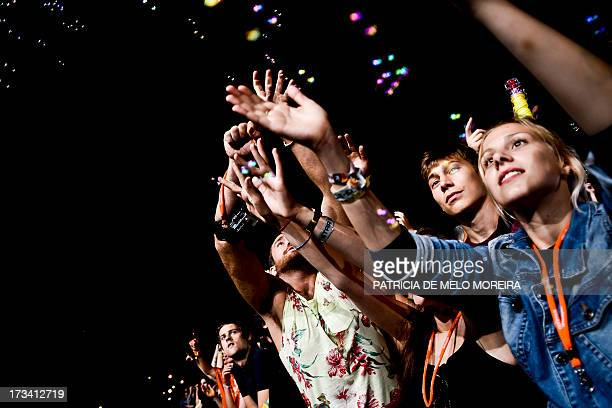 Fans of 2ManyDjs dance at the Optimus Alive music festival at Alges on the outskirts of Lisbon on July 13 2013 The Optimus Alive music festival runs...