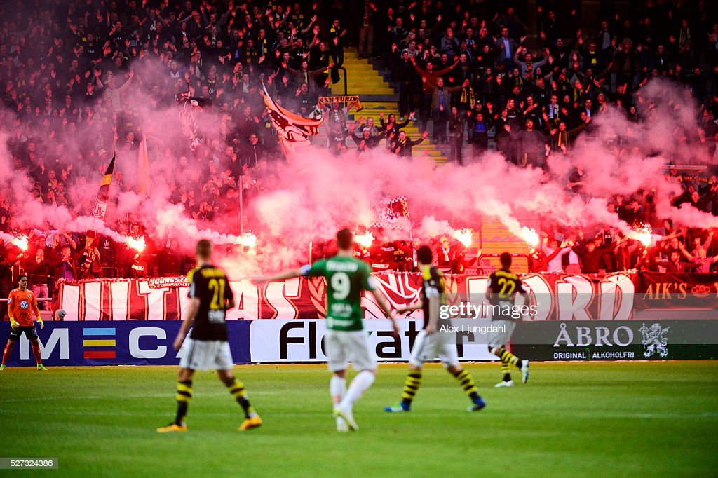 Fans of AIK burning bengals during the allsvenskan match between AIK and Jonkkoping Sodra IF at Friends arena on May 2, 2016 in Solna, Sweden.
