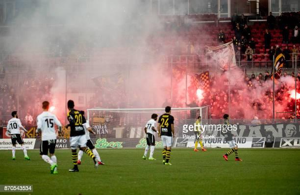 Fans of AIK lights up pyro during the Allsvenskan match between Orebro SK AIK at Behrn Arena on November 5 2017 in Orebro Sweden