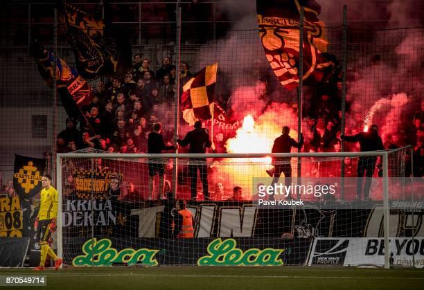 Fans of AIK lights up pyrotechnics during the Allsvenskan match between Orebro SK AIK at Behrn Arena on November 5 2017 in Orebro Sweden