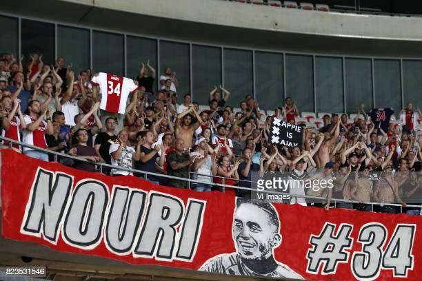 fans of Ajax singing for Abdelhak Nouri of Ajax banner of Abdelhak Nouri of Ajax during the UEFA Champions League third round qualifying first leg...