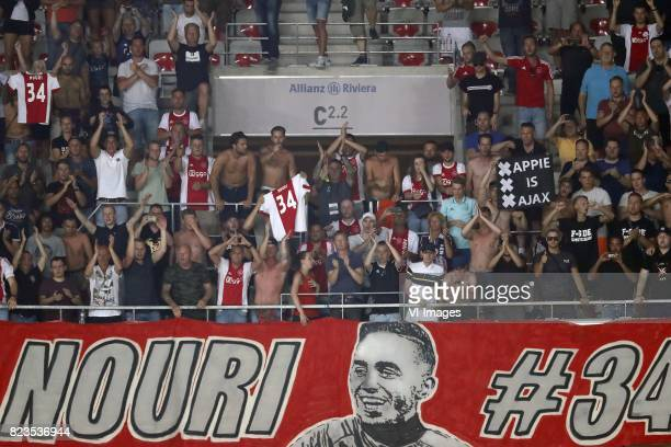 fans of Ajax singing for Abdelhak Nouri of Ajax banner of Abdelhak Nouri of Ajax during the UEFA Champions League third round qualifying first leg...