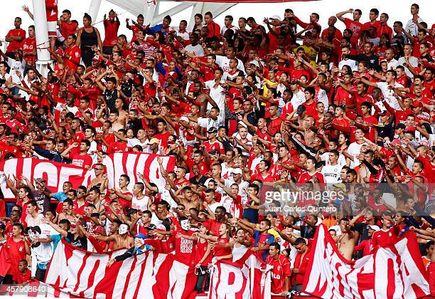 Fans of America de Cali cheer for their team during a match between América de Cali and Quindio as part of round 17 of Torneo Postobon II at Pascual...