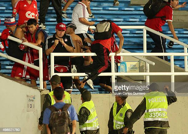 Fans of America de Cali fight with police during a match between America de Cali and Bucaramanga as part of fourth round of Quadrangular Group A...