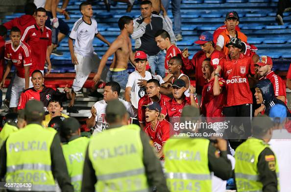Fans of America de Cali fight with the police during a match between América de Cali and Deportivo Pereira as part of round 19 of Torneo Postobon II...