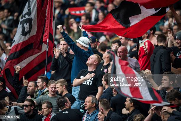 Fans of Amsterdam celebrate their teams third goal during the Uefa Europa League semi final first leg match between Ajax Amsterdam and Olympique...
