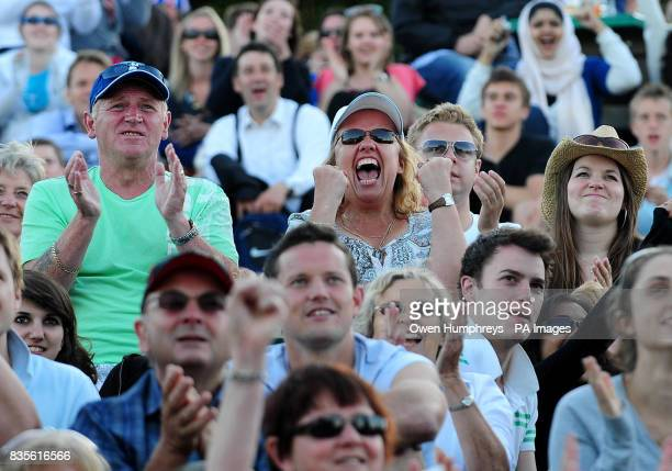 Fans of Andy Murray celebrate as he wins his match over USA's Robert Kendrick during the 2009 Wimbledon Championships at the All England Lawn Tennis...