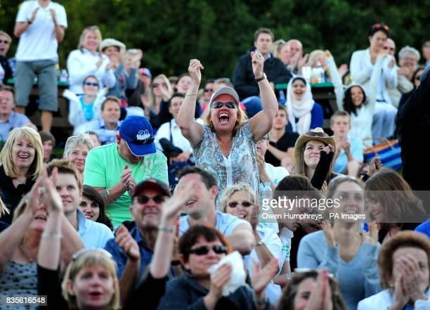 Fans of Andy Murray celebrates as he wins his match against USA's Robert Kendrick during the 2009 Wimbledon Championships at the All England Lawn...