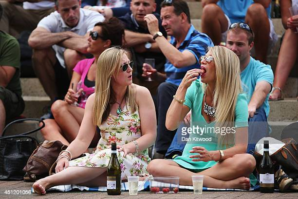 Fans of Andy Murray gather on 'Murray Mount' to sit in the sunshine and watch the Gentlemen's Singles second round match between Andy Murray of Great...