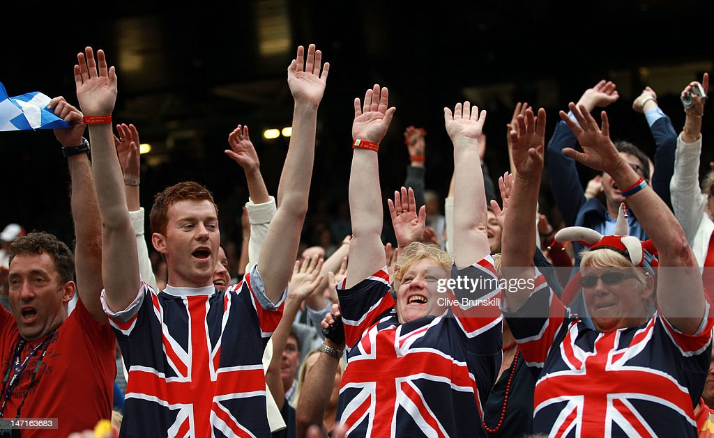 Fans of Andy Murray of Great Britain cheer during his Gentlemen's Singles first round match against Nikolay Davydenko of Russia on day two of the Wimbledon Lawn Tennis Championships at the All England Lawn Tennis and Croquet Club on June 26, 2012 in London, England.