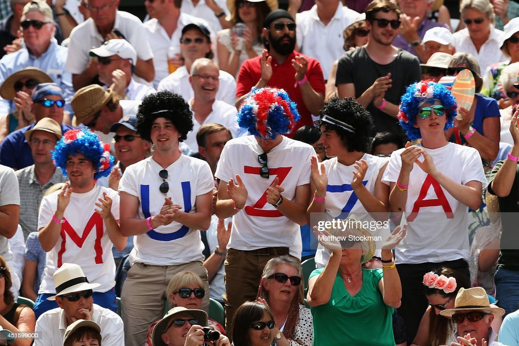 Fans of Andy Murray of Great Britain watch in the crowd to cheer him on during his Gentlemen's Singles quarterfinal match against Grigor Dimitrov of...