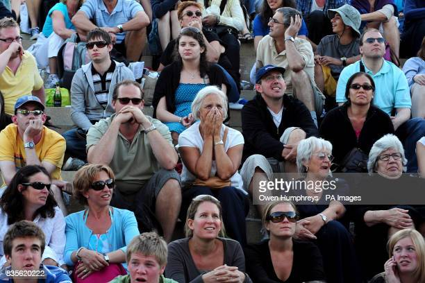 Fans of Andy Murray watch on during his match against USA's Robert Kendrick at the 2009 Wimbledon Championships at the All England Lawn Tennis and...