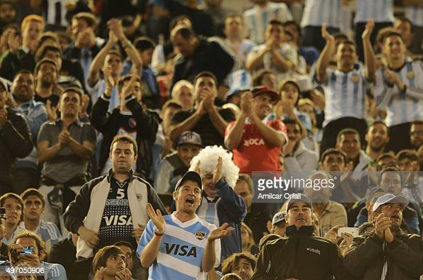 Fans of Argentina cheer for their team during a match between Argentina and Brazil as part of FIFA 2018 World Cup Qualifiers at Monumental Antonio...