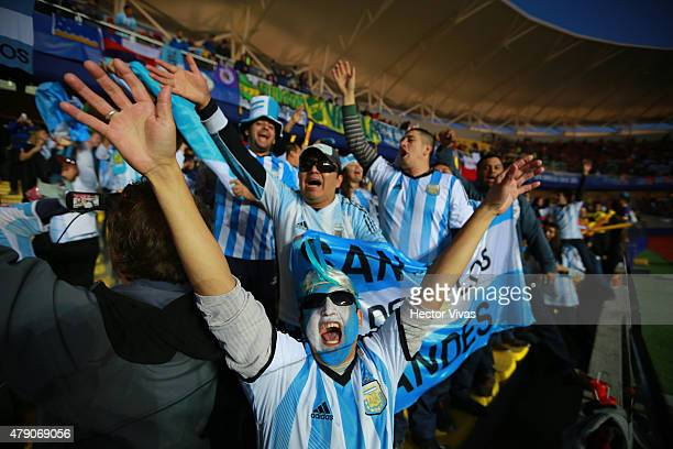 Fans of Argentina cheer for their team prior to the 2015 Copa America Chile Semi Final match between Argentina and Paraguay at Ester Roa Rebolledo...
