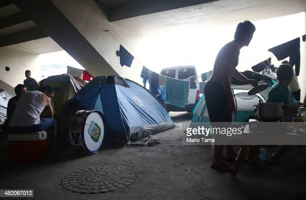 Fans of Argentina's national team gather in the Sambodrome parking lot which is being used as a makeshift campground by Argentines ahead of their...