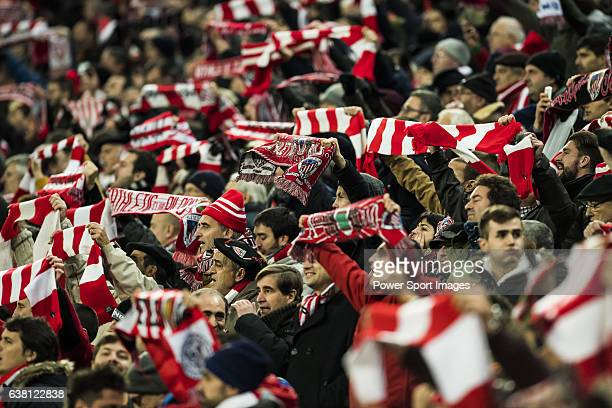 Fans of Athletic Club cheer on their team during their Copa del Rey Round of 16 first leg match between Athletic Club and FC Barcelona at San Mames...