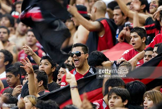 Fans of Atlas from Mexico celebrate their victory against Boca Juniors from Argentina during their Libertadores Cup match in Guadalajara Mexico on...