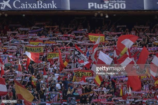 Fans of Atletico de Madrid cheer for their team during the La Liga match between Club Atletico de Madrid and Sevilla FC at Vicente Calderon Stadium...