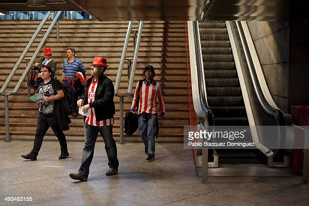 Fans of Atletico de Madrid walk in the Atocha train station to catch their train to Lisbon a day before the UEFA Champions league Final of Real...
