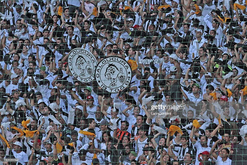 Fans of Atletico MG celebrate during a match between Botafogo and Atletico MG as part ot the Brazilian Championship at Independence Stadium on August 19, 2012 in Belo Horizonte, Brazil.