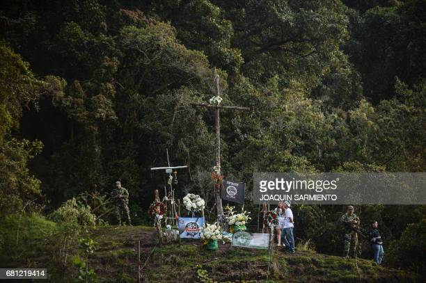 TOPSHOT Fans of Atlético Nacional visit the spot of the crash where perished the players of Brazilian club Chapecoense near la Union Antioquia...