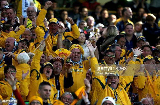 Fans of Australia celebrate during the 2015 Rugby World Cup Semi Final match between Argentina and Australia at Twickenham Stadium on October 25 2015...