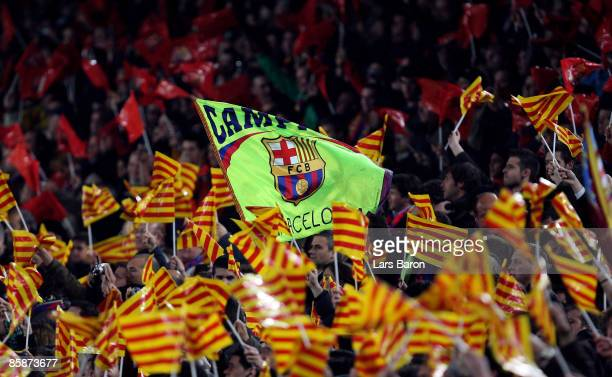 Fans of Barcelona wave flags during the UEFA Champions League quarter final first leg match between FC Barcelona and FC Bayern Munich at the Camp Nou...