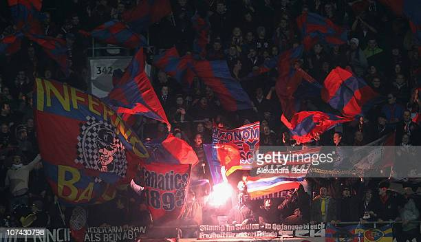 Fans of Basel light up a fire during the Champions League Group E match between FC Bayern Muenchen and FC Basel at Allianz Arena on December 8 2010...