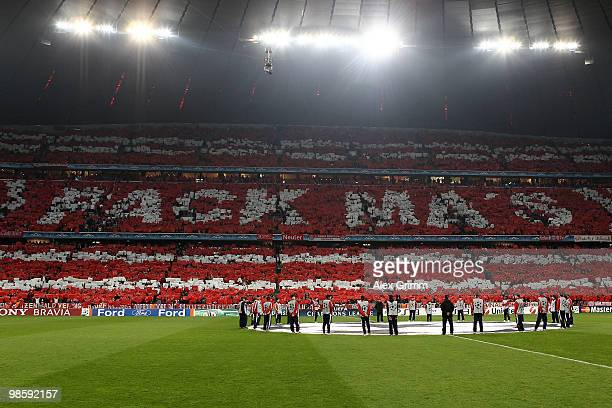Fans of Bayern cheer for their team during the UEFA Champions League semi final first leg match between FC Bayern Muenchen and Olympic Lyon at...