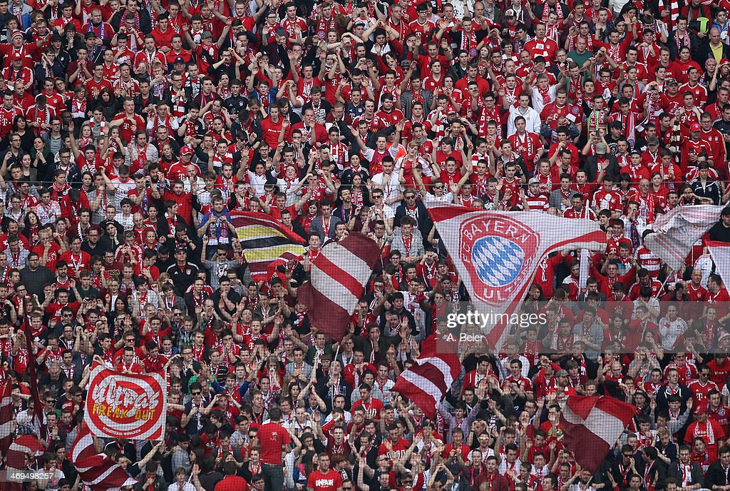 Fans of Bayern Muenchen celebrate during the Bundesliga match between FC Bayern Muenchen and SC Freiburg at Allianz Arena on February 15, 2014 in Munich, Germany.