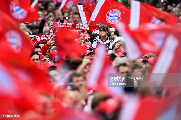 Fans of Bayern Muenchen celebrate winning the Bundesliga titel at Marienplatz on May 24 2015 in Munich Germany