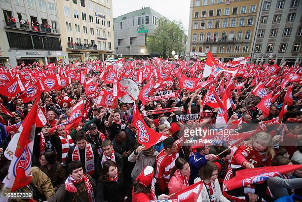 Fans of Bayern Muenchen celebrating the German championship title at Marienplatz on May 11 2013 in Munich Germany