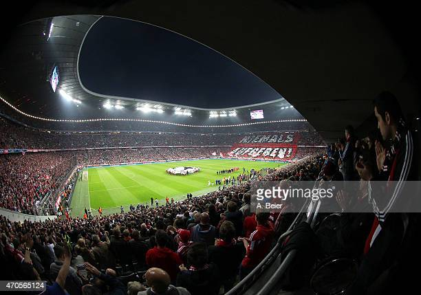 Fans of Bayern Muenchen perform a huge banner reading 'Never give up' before the Champions League quarter final second leg match between FC Bayern...