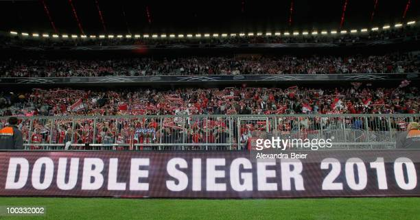 Fans of Bayern Muenchen react after their team's loss as a screen reads 'double winner 2010' during the public viewing of UEFA Champions League Final...