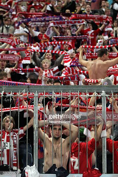 Fans of Bayern Muenchen react after their team's loss during the public viewing of UEFA Champions League Final match between FC Bayern Muenchen and...