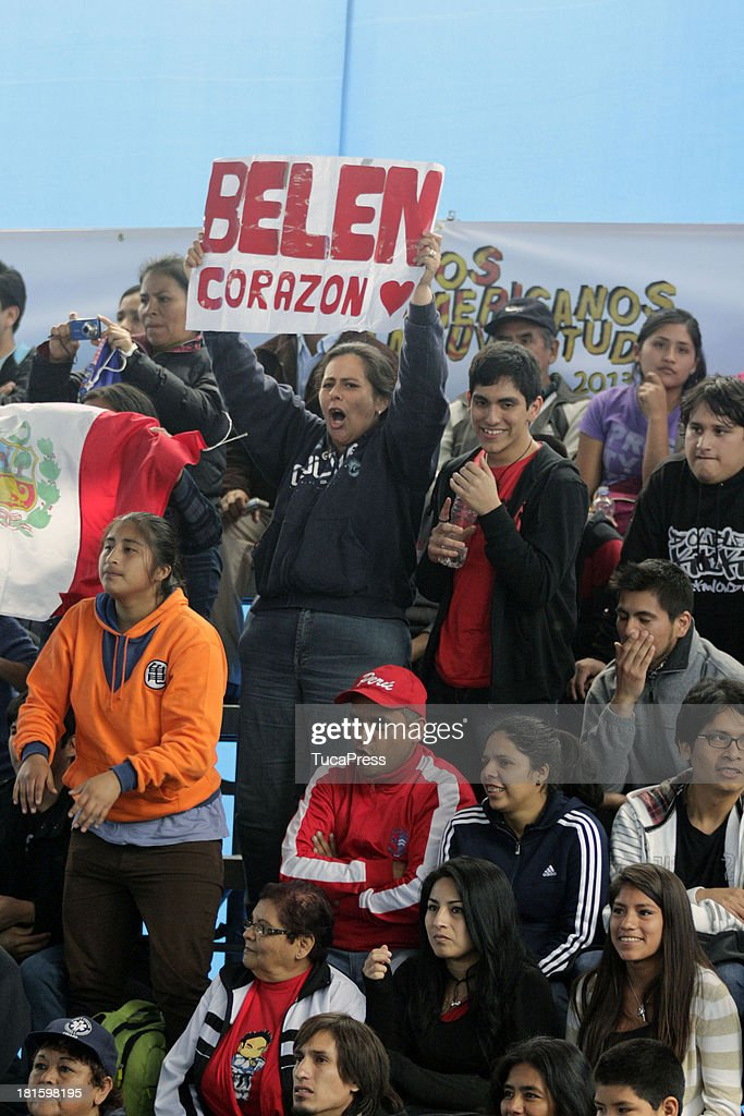 Fans of Belen Costa Ortega of Peru cheer for her during the Women's 63 kg Taekwondo as part of the I ODESUR South American Youth Games at on September 22, 2013 in Lima, Peru.
